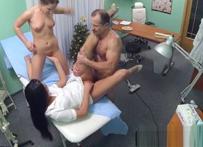 Nurse tugs physician with patient in..