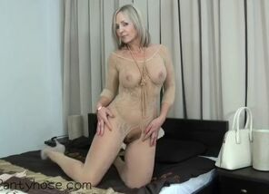 Ash-blonde mummy in fishnet  pantyhose